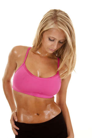A woman looking down with her sweaty body. photo