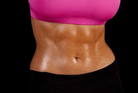 a close up of a woman's stomach with sweat dripping off of it photo