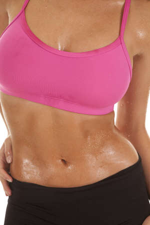 A woman's body all sweaty from working out. photo