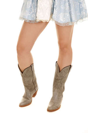 knee boots: A picture of a womans legs wearing cowgirl boots. Stock Photo
