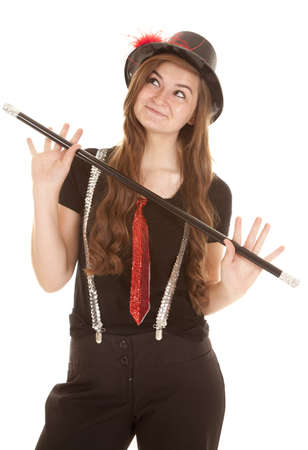 a teen girl showing her jazzy side by her dance cane and hat. photo