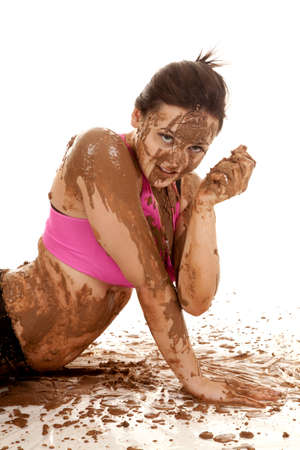a woman covered in brown mud all over her face and body. Stock Photo - 15002358