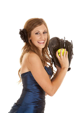 mit: A teen girl with a smile on her face in her formal holding a softball and mit. Stock Photo