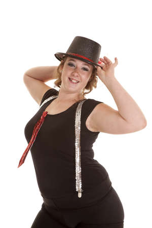a teen girl showing her style holding on her top hat in her tie and suspenders photo