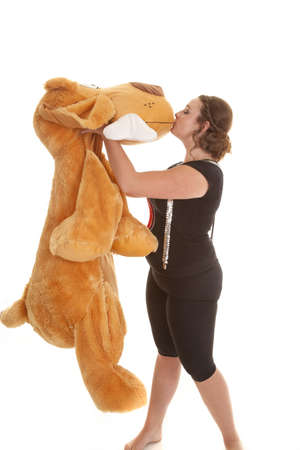 A teen girl in her jazzy outfit kissing her pet animal. photo