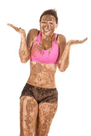 A woman with a smile on her face covered in mud. photo