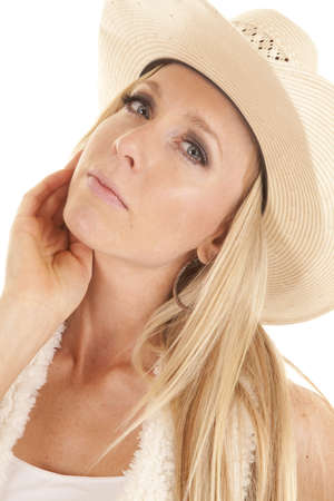 A cowgirl with her head bent to the side with a serious expression on her face. Stock Photo - 15726846