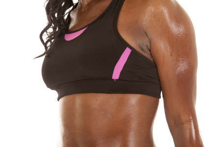 A close up of a womans body wet with sweat photo