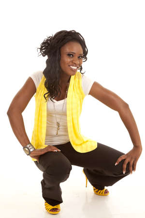 a woman showing off her fashion wearing yellow with a smile on her face. photo