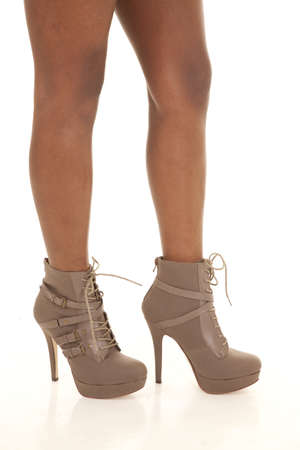 heeled: An African Americans legs in her heeled boots showing some style.
