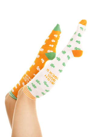 A woman with socks in the air.  They have luck clovers on them. Stock Photo - 15816037