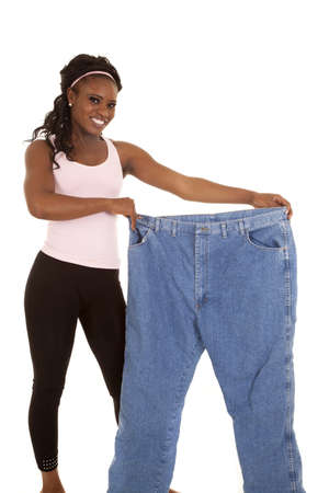 a woman holding out her big pants with a big smile photo