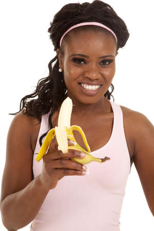 banana: A woman with a big smile on her face holding on to her banana Stock Photo