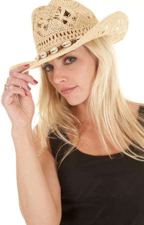 A woman in a cowboy hat is looking with a slight smile. photo