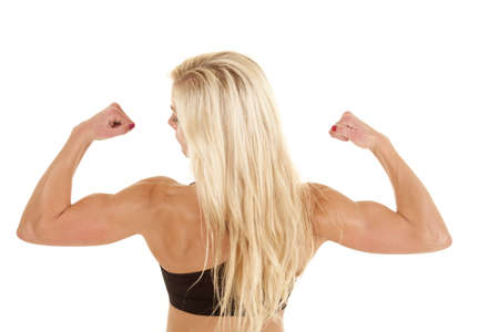 A woman from the back flexing her arms. photo