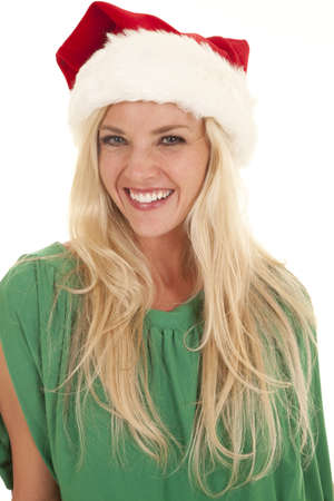 A woman in a green blouse and a santa hat smiling. photo