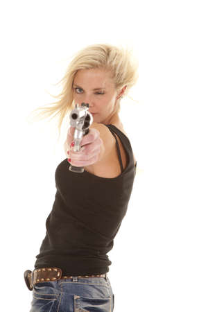 A woman is pointing a pistol and looks serious.