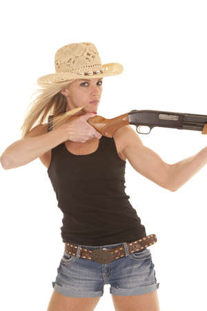 a woman holding on to her rifle with a serious expression on her face. photo