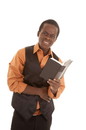 A man showing off his confused expression on his face while he is reading a book. Stock Photo - 16035337