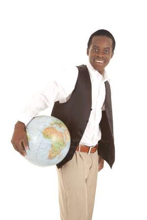 Un hombre con una gran sonrisa en su cara que sostiene el mundo en sus manos. Foto de archivo - 16035370