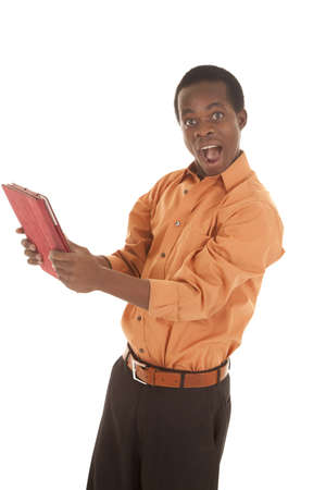 A man with a surprised expression on his face holding on to his pad Stock Photo - 16035381