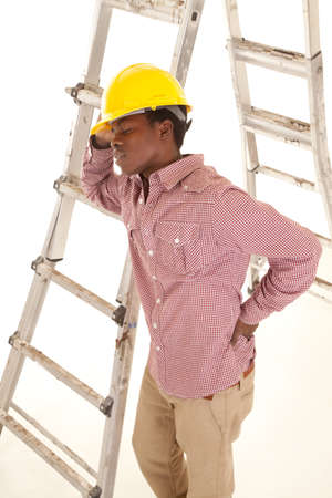 A construction worker taking a break by leaning up against the ladder. Stock Photo - 16035303