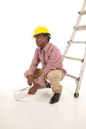 A man squating down taking a break from his frustrations. Stock Photo - 16035355
