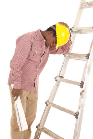 A construction worker leaning up against a ladder taking a break Stock Photo - 16035302
