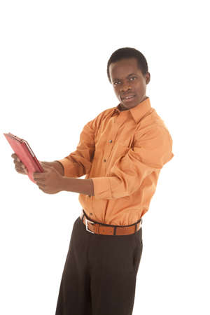 A man with a confused expression on his face holding out his pad. Stock Photo - 16035377