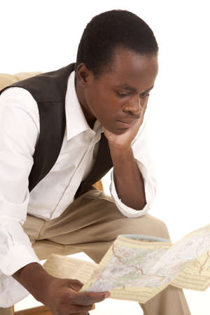 A man looking at a road map with a serious expression. photo