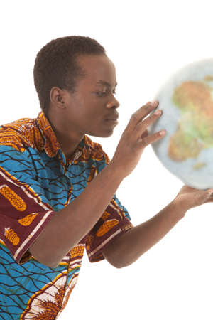 A man holding the world globe in his hands looking up close. Stock Photo - 16035301