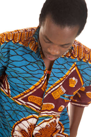 A man looking down in his colorful shirt with a serious expression on his face. Stock Photo - 16035278