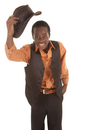 african business man: A man with a smile on his face taking off his cowboy hat Stock Photo