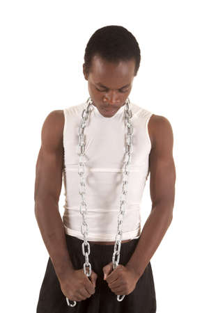 A man with a metal chain wrapped around his neck looking down. Stock Photo - 16035340