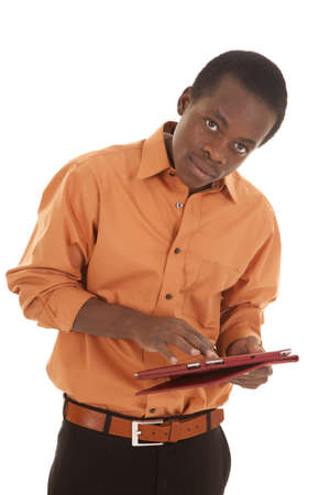A man with a serious expression on his face working on his pad. Stock Photo - 16035348