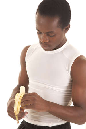 A man peeling his banana eating healthy. photo