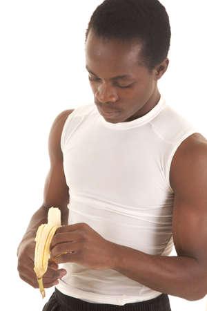 A man peeling his banana eating healthy. Stock Photo - 16035317