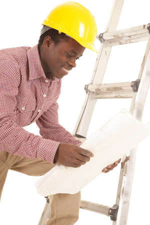 A construction worker looking at his plans with a smile on his face Stock Photo - 16035270