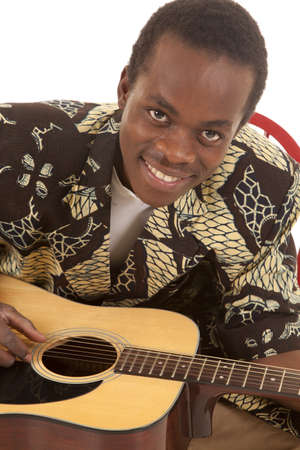 A close up of a man playing his guitar with  a  smile on his face. Stock Photo - 16035281