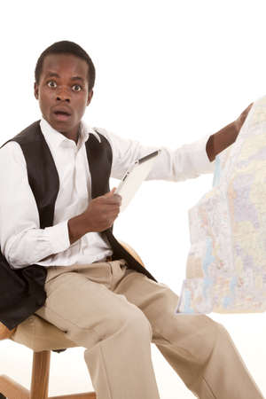 A man sitting on his chair with a shocked expression on his face holding on to his road map and tablet. Stock Photo - 16035309