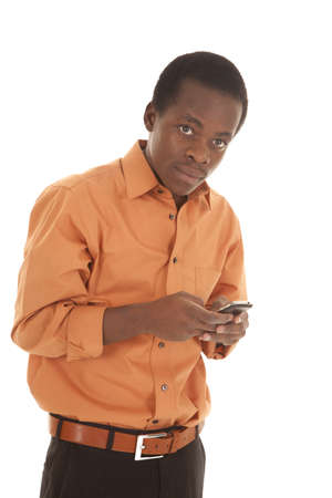 A man with a serious expression on his face text-ing on his cell phone. photo