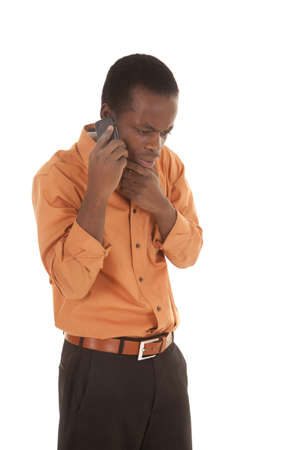 A man listening on his cell phone with a upset expression on his face Stock Photo - 16035384
