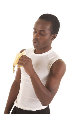 A man looking down at his banana before taking a bite. Stock Photo - 16035339
