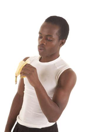 A man looking down at his banana before taking a bite. Stock Photo - 16035339