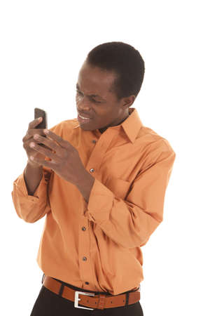 A man with a confused expression  looking at his phone. photo
