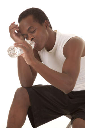a man taking a break from working out and getting a big drink of water Stock Photo - 16035295