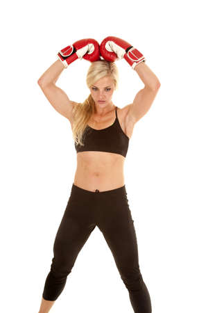 A woman standing with her boxing gloves on her head. Stock Photo - 16085430