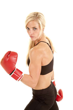 A woman with her boxing gloves with a serious expression. photo