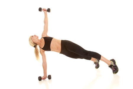 woman lifting weights: a woman lifting her weight up in the air.