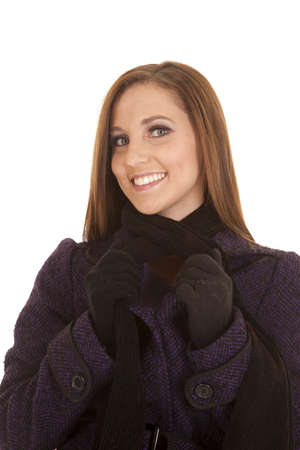 A close up of a woman with a smile on her face holding on to her coat. Stock Photo - 16242795